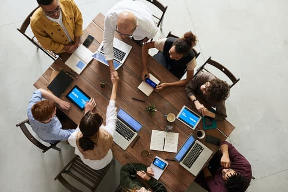 A group of people in a room. Community-Manager-engagement.jpg.
